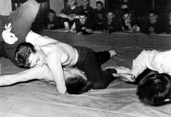 That's me in the back row -- I didn't have to wrestle, I was the assistant coach, so I didn't go topless ever.