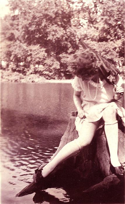 My Kodak Brownie photo of Aunt Bertha adjusting her stocking, Sand Dunes Vermont, 1949.